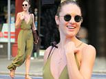 Candice Swanepoel has a beaming smile as she walks on the street of NYC wearing a flowing green dress\n\nPictured: Candice Swanepoel\nRef: SPL1096770  070815  \nPicture by: XactpiX/Splash\n\nSplash News and Pictures\nLos Angeles: 310-821-2666\nNew York: 212-619-2666\nLondon: 870-934-2666\nphotodesk@splashnews.com\n