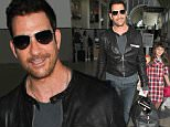 Dylan McDermott (The Practice) is spotted with his adorable daughter as they catch a flight out of Los Angeles.  The hunky actor was seen at LAX pulling his luggage as his daughter trailed closely behind. \n\nPictured: Dylan McDermott\nRef: SPL1097570  070815  \nPicture by: Splash News\n\nSplash News and Pictures\nLos Angeles: 310-821-2666\nNew York: 212-619-2666\nLondon: 870-934-2666\nphotodesk@splashnews.com\n