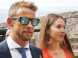 Jenson Button and his wife Jessica Michibata arrive at Castle Cornet, Guernsey for the wedding of Richard Goddard. See SWNS story SWBUTTON; Formula 1 stars came to Guernsey over the weekend, believed to be celebrating the marriage of Jenson Buttonís manager, Richard Goddard. Button and David Coulthard were two that were seen walking through Castle Cornet, thought to be the location for the occasion. It was also reported that former F1 driver Paul di Resta and former team principal Ross Brawn were present. Some members of the public who were in the castle at the time took photographs and watched the celebrities walk past. Goddard is from Guernsey and Button lived in the island from 2010 to 2012.