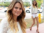 August 9, 2015: Model Chrissy Teigen shows off her long legs in very short shorts as she steps out for lunch with husband John Legend In Miami Beach.\nMandatory Credit: INFphoto.com Ref: infusmi-11/13