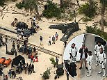 *NO WEB UNTIL 00:01 MONDAY 10TH AUGUST**\nEXCLUSIVE: Cast of the new Star Wars movie Episode 7 - The Force Awakens are seen enjoying some down time in between takes. Actors dressed as Storm Troopers can be seen relaxing by what looks like a downed aircraft and a hangar door. A short distance away a stock pile of galactic weapons can be seen laid out.\n\nPictured: Star Wars\nRef: SPL1092448  090815   EXCLUSIVE\nPicture by: Jenkins/Splash News\n\nSplash News and Pictures\nLos Angeles:310-821-2666\nNew York:212-619-2666\nLondon:870-934-2666\nphotodesk@splashnews.com\n
