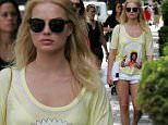 EXCLUSIVE: Margot Robbie is seen out and about in downtown Toronto where she went for a walk on a warm summer afternoon with a female companion.  Robbie was wearing a yellow t-shirt with an image of Jimi Hendrix on the front.  \n\nPictured: Margot Robbie\nRef: SPL1094008  080815   EXCLUSIVE\nPicture by: Splash News\n\nSplash News and Pictures\nLos Angeles: 310-821-2666\nNew York: 212-619-2666\nLondon: 870-934-2666\nphotodesk@splashnews.com\n