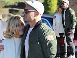 Celebrity Apprentice stars Sophie Monk and Matt Cooper could not keep their hands off each other during a break..between filming scenes for the Channel 9 show...