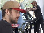 Picture Shows: Ryan Gosling  August 09, 2015\n \n 'La La Land' actor Ryan Gosling and a friend stop by a gas station to fill up in Los Angeles, California. \n \n Ryan made sure to clean the front and back windows while waiting for the car to fill up.\n \n Exclusive - All Round\n UK RIGHTS ONLY\n \n Pictures by : FameFlynet UK © 2015\n Tel : +44 (0)20 3551 5049\n Email : info@fameflynet.uk.com
