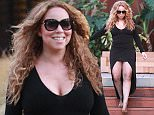 **NO WEB UNTIL 1PM GMT TUESDAY 11th AUGUST** UK CLIENTS MUST CREDIT: AKM-GSI ONLY EXCLUSIVE: Malibu, CA - Ultimate diva Mariah Carey stepped out of her $10,000 a night Malibu rental home this week, looking seriously glam in a low-cut black dress, fishnet tights and leopard pumps. The R&B princess is seemingly on top of the world right now, having just received a star on the Hollywood Walk of Fame, releasing a new hit track with Justin Bieber, and vacationing around Europe with her billionaire beau James Packer.  Pictured: Mariah Carey Ref: SPL1098468  090815   EXCLUSIVE Picture by: AKM-GSI