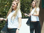 EXCLUSIVE Coleman-Rayner. \nLos Angeles, CA. USA. August 5th, 2015.\nLouis Tomlinson's pregnant ex-girlfriend Briana Jungwirth shows off her growing baby bump while applying for a passport in Los Angeles today. \nCREDIT LINE MUST READ: Coqueran/Coleman-Rayner.\nTel US (001) 310-474-4343 - office \nTel US (001) 323 545 7584 - cell\nwww.coleman-rayner.com. Los Angeles CA, USA