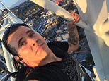 Steve O stunt, climbs a crane with a blow-up killer whale.