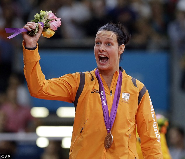 'Beating': Dutch judo competitor Edith Bosch, pictured after winning a bronze medal at London 2012, claimed on Twitter that a 'drunken' spectator had thrown the bottle