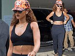 10.AUGUST.2015 - NEW YORK - USA A CASUAL LOOKING RIHANNA HEADS TO THE DENTIST OFFICE IN SOHO. THE BARBADIAN SINGER SONGWRITER WAS SHOWING HER MIDRIFF IN A CROP TOP AND SHOWING HER TATTOOS. SHE FINISHED THE LOOK WITH A CAP, SUNGLASSES, NECKLACE, BRACELETS AND BLACK HEEL SHOES. BYLINE MUST READ:  XPOSUREPHOTOS.COM ***UK CLIENTS - PICTURES CONTAINING CHILDREN PLEASE PIXELATE FACE PRIOR TO PUBLICATION *** **UK CLIENTS MUST CALL PRIOR TO TV OR ONLINE USAGE PLEASE TELEPHONE 0208 344 2007*