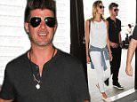 LOS ANGELES, CA - AUGUST 10: Robin Thicke and April Love Geary are seen at LAX. on August 10, 2015 in Los Angeles, California.  (Photo by GVK/Bauer-Griffin/GC Images)