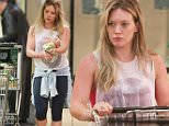 Hilary Duff shopping for health foods at Whole Foods after looking like she just worked out. August 10, 2015. X17online.com