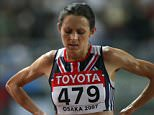 OSAKA, JAPAN - AUGUST 25:  Jo Pavey of Great Britain looks exhausted after competing in the Women's 10,000m final on day one of the 11th IAAF World Athletics Championships on August 25, 2007 at the Nagai Stadium in Osaka, Japan.  (Photo by Alexander Hassenstein/Bongarts/Getty Images) *** Local Caption *** Jo Pavey