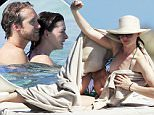 Us actress Anne Hathaway and husband Adam Shulman enjoy a day by the sea in Formentera as guests on board of Valentino's yacht.\n\nPictured:  Anne Hathaway, Adam Shulman \nRef: SPL1100836  120815  \nPicture by: Splash News\n\nSplash News and Pictures\nLos Angeles: 310-821-2666\nNew York: 212-619-2666\nLondon: 870-934-2666\nphotodesk@splashnews.com\n