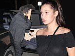 West Hollywood, CA - Bella Hadid and her boyfriend The Weeknd (Abel Tesfaye) arrive for a low-key dinner date at The Nice Guy in West Hollywood. The 18-year-old model wore a sheer black top, black leggings, a grey sweater tied around the waist and a pair of black Louboutin boots. The camera shy Canadian singer covered his face as he dashed inside the celebrity hotspot.\nAKM-GSI          August 11, 2015\nTo License These Photos, Please Contact :\nSteve Ginsburg\n(310) 505-8447\n(323) 423-9397\nsteve@akmgsi.com\nsales@akmgsi.com\nor\nMaria Buda\n(917) 242-1505\nmbuda@akmgsi.com\nginsburgspalyinc@gmail.com