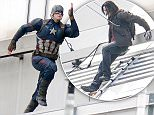 BERLIN, GERMANY - AUGUST 12:  A stuntman dressed as Captain America is seen during filming on the set of Captain America, Civil War on August 12, 2015 in Berlin, Germany.  (Photo by Chad Buchanan/GC Images)