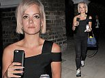 Lily Allen pictured leaving a house in East London after a long day at a photo shoot, Lily drove her own car home.\n\nPictured: Lily Allen\nRef: SPL1084166  120815  \nPicture by: KP/NW / Splash News\n\nSplash News and Pictures\nLos Angeles: 310-821-2666\nNew York: 212-619-2666\nLondon: 870-934-2666\nphotodesk@splashnews.com\n
