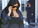 Kim Kardashian looking fantastic in all black leaving the studio