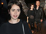LONDON, ENGLAND - AUGUST 11:  Lily Collins (L) and Jamie Campbell Bower attend the launch of W London - Leicester Square's Britpop Vinyl Collection curated by DJ Lauren Laverne at W London - Leicester Square on August 11, 2015 in London, England.   Pic Credit: Dave Benett