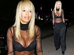 Rita Ora shows off her assets in a very revealing see-through outfit showing her bra when out and about in NYC  Pictured: Rita Ora Ref: SPL1100419  110815   Picture by: XactpiX/splash  Splash News and Pictures Los Angeles: 310-821-2666 New York: 212-619-2666 London: 870-934-2666 photodesk@splashnews.com