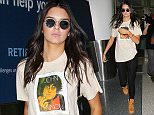 11.AUGUST.2015 - LOS ANGELES - USA *STRICTLY AVAILABLE FOR UK AND GERMANY USE ONLY* REALITY STAR AND MODEL, KENDALL JENNER RETURNS TO LOS ANGELES ON A FLIGHT AT LAX AIRPORT AFTER A QUICK TRIP TO LAS VEGAS. KENDALL WAS ESCORTED TO HER RIDE PAST THE CAMERAS IN A JOHN LENNON T-SHIRT AND BLACK LEGGINGS WITH WORK BOOTS. BYLINE MUST READ : XPOSUREPHOTOS.COM ***UK CLIENTS - PICTURES CONTAINING CHILDREN PLEASE PIXELATE FACE PRIOR TO PUBLICATION *** *UK CLIENTS MUST CALL PRIOR TO TV OR ONLINE USAGE PLEASE TELEPHONE 0208 344 2007*