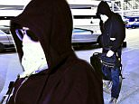 141109, EXCLUSIVE:  Val Kilmer hides his face with a bandana and sunglasses while making his way through LAX. Los Angeles, California - Tuesday August 11, 2015. Photograph: © Cathy Gibson, PacificCoastNews. Los Angeles Office: +1 310.822.0419 sales@pacificcoastnews.com FEE MUST BE AGREED PRIOR TO USAGE