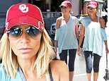 """Beverly Hills, CA - Broadway sweetheart Kristin Chenoweth was spotted holding hands with a gal pal in the 90210 on Wednesday afternoon, seemingly not noticing that she was wearing a t-shirt that said """"THURSDAY""""!\n \n AKM-GSI          August 12, 2015\nTo License These Photos, Please Contact :\nSteve Ginsburg\n(310) 505-8447\n(323) 423-9397\nsteve@akmgsi.com\nsales@akmgsi.com\nor\nMaria Buda\n(917) 242-1505\nmbuda@akmgsi.com\nginsburgspalyinc@gmail.com"""