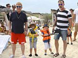 PLEASE CALL INF NYC DIRECTLY FOR USAGE at 212-582-0066 OR 917-496-6766 August 13, 2015: Elton John and David Furnish with their kids Zachary and Elijah arriving at Club 55 restaurant in Pamplona Beach, Saint-Tropez, France. Mandatory Credit: INFphoto.com Ref.: inffr-09/PAP08151248
