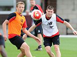 LIVERPOOL, ENGLAND - AUGUST 07:  (THE SUN OUT, THE SUN ON SUNDAY OUT) Lucas Leiva and James Milner of Liverpool in action during a training session at Melwood Training Ground on August 7, 2015 in Liverpool, England.  (Photo by John Powell/Liverpool FC via Getty Images)
