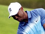 Tiger Woods hits on the 10th hole during the first round of the PGA Championship golf tournament Thursday, Aug. 13, 2015, at Whistling Straits in Haven, Wis. (AP Photo/Jae Hong)