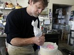 FILE  - In this March 10, 2014 file photo, Masterpiece Cakeshop owner Jack Phillips decorates a cake inside his store, in Lakewood, Colo. Phillips a suburban Denver baker who wouldnít make a wedding cake for a same-sex couple cannot cite his religious beliefs in refusing them service because it would lead to discrimination, the Colorado Court of Appeals ruled Thursday, Aug. 13, 2015. (AP Photo/Brennan Linsley, File)
