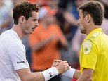 MONTREAL, ON - AUGUST 12:   Andy Murray of Great Britain shakes hands with Tommy Robredo of Spain during day three of the Rogers Cup at Uniprix Stadium on August 12, 2015 in Montreal, Quebec, Canada.  Andy Murray defeated Tommy Robredo 6-4, 7-5.  (Photo by Minas Panagiotakis/Getty Images)