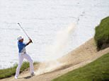 Rickie Fowler hits out of a bunker on his fourth try on the second hole during the first round of the PGA Championship golf tournament Thursday, Aug. 13, 2015, at Whistling Straits in Haven, Wis. (AP Photo/Brynn Anderson)