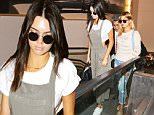 Kendall Jenner and Hailey Baldwin catch a flight out of LAX headed to meet Kylie in Mexico for more birthday celebrations. Wednesday, August 12, 2015. X17online.com