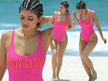 "Kylie Jenner wears a hot pink swimsuit while walking on Casa Aramara beach in Mexico\nMANDITORY MENTION OF ""CASA ARAMARA"""