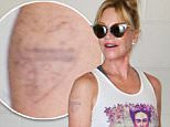 Melanie Griffith was spotted at her gym in Beverly Hills, her Antonio tattoo slowly fading from her freckled shoulder, on Thursday, August 13, 2015 X17online.com