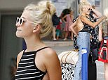 12.AUG.2015 - MONACO **EXCLUSIVE ALL ROUND PICTURES** POP SINGER PIXIE LOTT SHOWS OFF HER TAN IN A BACKLESS STRIPEY TOP AS SHE ARRIVES IN MONACO! BYLINE MUST READ : E-PRESS / XPOSUREPHOTOS.COM *AVAILABLE FOR UK SALE ONLY* ***UK CLIENTS - PICTURES CONTAINING CHILDREN PLEASE PIXELATE FACE PRIOR TO PUBLICATION ***
