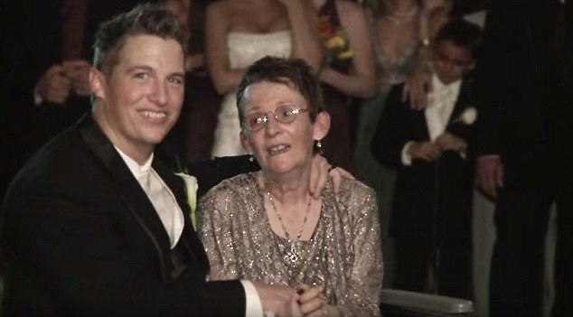 Proud son: Throughout the dance, Luke smiled, kissed and whispered in the ear of his mother, who had only been diagnosed with ALS the year before
