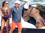** HOLD ** UK MAIL ONLINE EXCLUSIVE ***12.AUGUST.2015 - AMALFI COAST - ITALY *** EXCLUSIVE PICTURES ***¯¯*STRICTLY NOT AVAILABLE IN ITALY AND FRANCE* HOLLYWOOD ACTOR BRADLEY COOPER AND SUPERMODEL IRINA SHAYK CONTINUE THEIR ROMANTIC GETAWAY ON THE AMALFI COAST IN ITALY. THE LOVED UP PAIR WERE SEEN BOARDING A BOAT AND STROLLING HAND IN HAND THROUGH THE TOWN! BYLINE MUST READ : XPOSUREPHOTOS.COM ***UK CLIENTS - PICTURES CONTAINING CHILDREN PLEASE PIXELATE FACE PRIOR TO PUBLICATION *** UK AND USA CLIENTS MUST CALL PRIOR TO TV OR ONLINE USAGE PLEASE TELEPHONE 0208 344 2007**