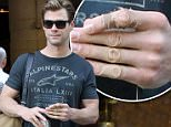 Picture Shows: Chris Hemsworth  August 13, 2015.. .. 'Thor' actor Chris Hemsworth is spotted leaving his hotel, coffee in hand, to head to the set of the new 'Ghostbusters' film in Boston, Massachusetts. .. .. The Australian heartthrob was all smiles for the cameras; despite the fact that he appeared to have an injury on his left index finger... .. Exclusive All Rounder.. UK RIGHTS ONLY.. .. Pictures by : FameFlynet UK ? 2015.. Tel : +44 (0)20 3551 5049.. Email : info@fameflynet.uk.com