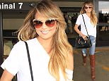 """Supermodel, Chrissy Teigen is all smiles as she arrives back in Los Angeles.  The """"Sports Illustrated Swimsuit"""" model was seen at LAX in blue jeans, brown knee-high boots & a white v-neck shirt.   Pictured: Chrissy Teigen Ref: SPL1102179  130815   Picture by: Sharky / Splash News  Splash News and Pictures Los Angeles: 310-821-2666 New York: 212-619-2666 London: 870-934-2666 photodesk@splashnews.com"""