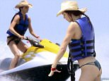 Kendall Jenner is seen sunning herself on holiday in Mexico with sister Kylie Jenner and Hailey Baldwin, 13 August 2015\n14 August 2015.\nPlease byline: Vantagenews.co.uk