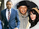 """Actor Terrence Howard walks into a Los Angeles court for a hearing in which the """"Empire"""" star is attempting to overturn a 2012 divorce settlement on the grounds his ex-wife extorted him, Thursday, Aug. 13, 2015, in Los Angeles. Attorneys for Howard's ex-wife, Michelle Ghent, contend that Howard cannot testify about any discussions the pair had during a four-month period between when the pair engaged in mediation and when it was signed. Los Angeles Superior Court Judge Thomas Trent Lewis is considering how much testimony about the discussions between Howard and Ghent can be offered. (AP Photo/Damian Dovarganes)"""