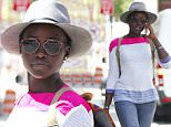 EXCLUSIVE: Lupita Nyong'o seen grabbing lunch with friends in SoHo, New York City.\n\nPictured: Lupita Nyong'o\nRef: SPL1101779  130815   EXCLUSIVE\nPicture by: Splash News\n\nSplash News and Pictures\nLos Angeles: 310-821-2666\nNew York: 212-619-2666\nLondon: 870-934-2666\nphotodesk@splashnews.com\n