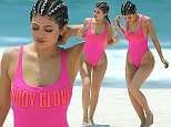 "Kylie Jenner wears a hot pink swimsuit while walking on Casa Aramara beach in Mexico\nMANDITORY MENTION OF ""CASA ARAMARA"""