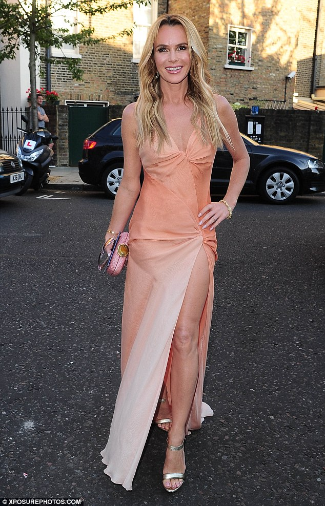 Summery trends: Amanda Holden stole the show at the ITV summer bash as she put on a leggy display in a peach-coloured floor-length dress with a plunging neckline