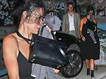 UK CLIENTS MUST CREDIT: AKM-GSI ONLY EXCLUSIVE: Los Angeles, CA  - Demi Moore enjoys a night out with much younger date as she sneaks out with her face covered.  Demi is looking a little shy, but still appears to have a little smile as she walks to her car.  Pictured: Demi Moore Ref: SPL1104633  170815   EXCLUSIVE Picture by: AKM-GSI / Splash News