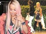 West Hollywood, CA - Rita Ora accompanies Wiz Khalifa into a L.A. recording studio after a night out at The Nice Guy. The talented duo appeared to be in a playful mood for their after hours collaboration. AKM-GSI           August 17, 2015 To License These Photos, Please Contact :    Steve Ginsburg  (310) 505-8447  (323) 423-9397  steve@akmgsi.com  sales@akmgsi.com    or    Maria Buda  (917) 242-1505  mbuda@akmgsi.com  ginsburgspalyinc@gmail.com