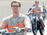"""Exclusive... 51825826 Actor Chris Hemsworth wears his Ghostbusters uniform as he rides a motorcycle on the set of """"Ghostbusters"""" on August 17, 2015 in Boston, Massachusetts. FameFlynet, Inc - Beverly Hills, CA, USA - +1 (818) 307-4813"""