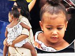 """Exclusive... 51825731 """"Keeping Up With the Kardashian"""" stars arrive on a small plane in St Barts on August 17, 2015. Pregnant Kim Kardashian was joined by her daughter North and sisters Kendall, Khloe and Kourtney, (along with her 3 children) as well as their mother Kris. Kourtney and Kris wore matching green jumpsuits. NO INTERNET USE WITHOUT PRIOR AGREEMENT FameFlynet, Inc - Beverly Hills, CA, USA - +1 (818) 307-4813"""