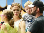 Exclusive... 51825282 Estranged couple Ben Affleck & Jennifer Garner seem desperate to put on a united front for their kids as they suffer through a festive family weekend trip with to Disney World in Orlando, Florida on August 16, 2015. With no nannies along for the ride and Ben's mom helping tend to the kids, the couple slogged through the heat and humidity, rarely interacting with each other. An eyewitness described them as acting 'emotionless' and 'like strangers.' Ben Affleck looked particularly miserable, openly showing his sadness and stress on the Dumbo ride, despite the visit to 'the happiest place on Earth.' CONTACT SALES - NO INTERNET USE WITHOUT PRIOR AGREEMENT FameFlynet, Inc - Beverly Hills, CA, USA - +1 (818) 307-4813